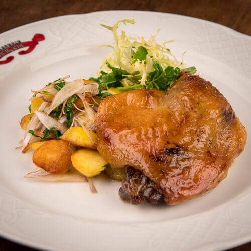 Homemade duck confit with baby roasted potatoes Cuisse de canard confite