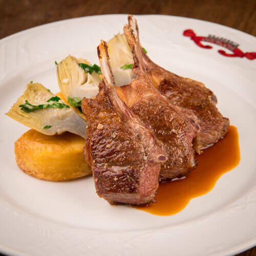 Welsh lamb chops with baby artichokes, glazed potatoes